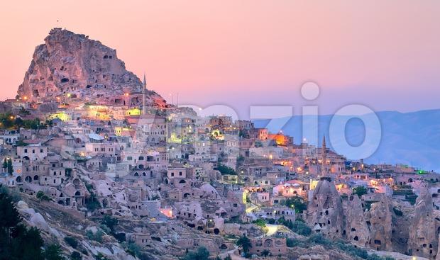 Uchisar cave city in Cappadocia, Turkey on sunset Stock Photo