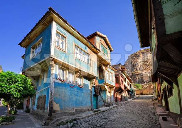 Old traditional ottoman house street with the Karahisar castle in background, Afyon, Turkey Stock Photo