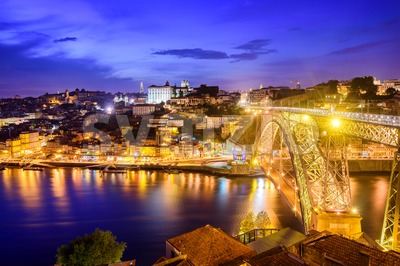 Ribeira and the Dom Luiz bridge at night, Porto, Portugal Stock Photo