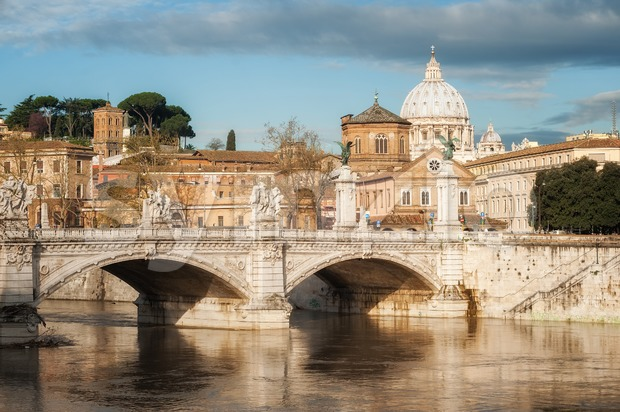 View of St. Peter's Basilica and bridges of Tiber river in Rome, Italy