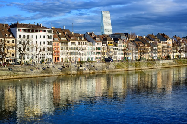 Klein Basel district on Rhine river shore with Roche Tower in background, Basel, Switzerland