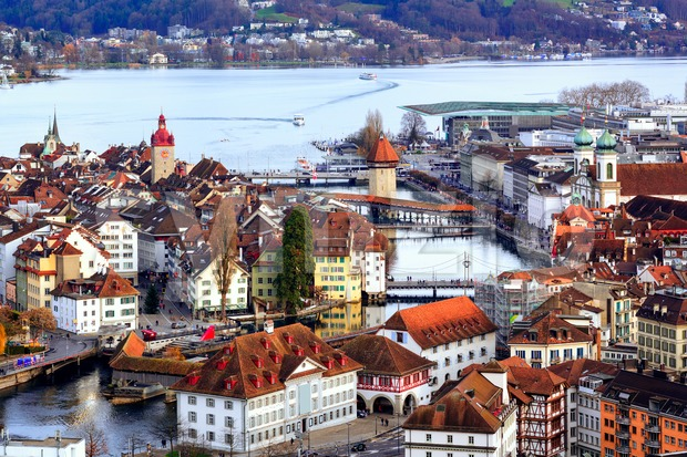 Aerial view of the red tiled roofs of the old town of Lucerne, wooden Chapel bridge, stone Water tower, Reuss ...