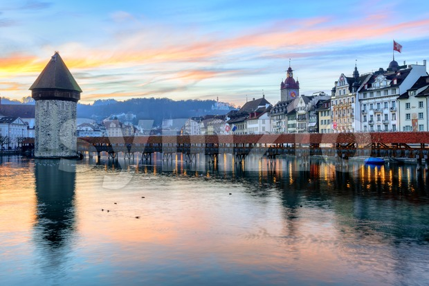Old town of Lucerne reflecting in the water of Reuss river on sunset, Lucerne, Switzerland