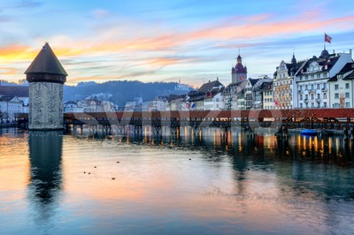 Wooden Chapel Bridge and Water Tower on sunset, Lucerne, Switzerland Stock Photo