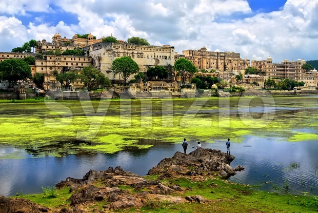 City Palace in Udaipur rising over Pichola lake, Rajasthan, India Stock Photo