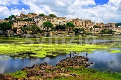 City Palace in Udaipur rising over Pichola lake, Rajasthan, India Stock Photo