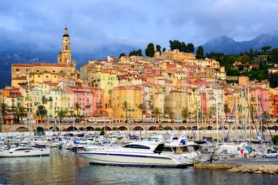 Yachts in the marina of colorful medieval town Menton on french Riviera, Provence, France Stock Photo