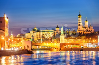Moscow Kremlin glowing in the evening light over Moskva River, Russia Stock Photo