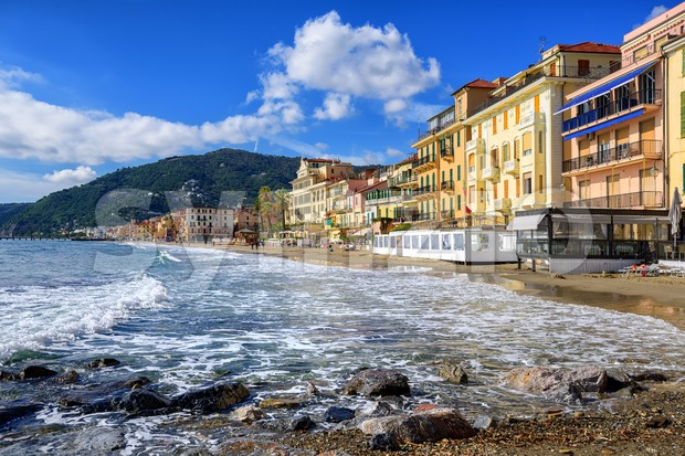 Mediterranean beach promenade in traditional touristic town Alassio on italian Riviera by San Remo, Liguria, Italy