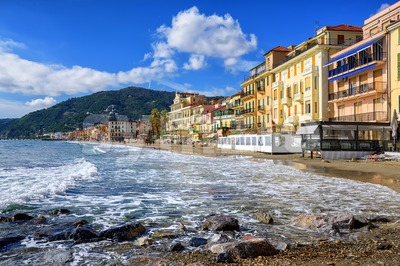 Mediterranean beach in touristic town Alassio on italian Riviera, Italy Stock Photo