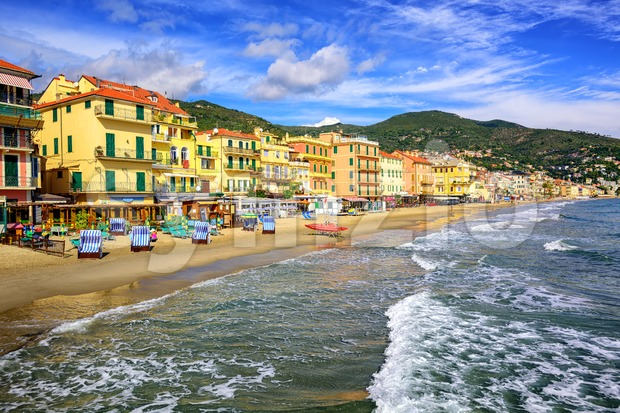 Empty mediterranean sand beach in traditional touristic town Alassio on italian Riviera by San Remo, Liguria, Italy