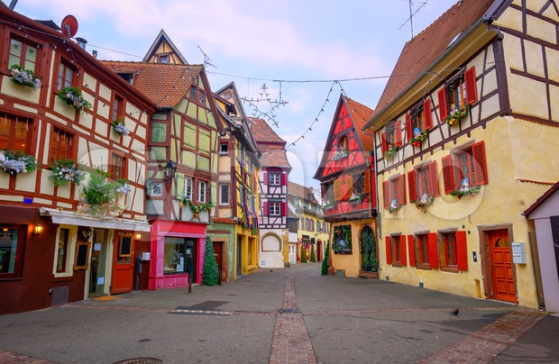 Traditional colorful half timbered houses with Christmas decoration in the early morning in Colmar, Alsace, France