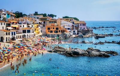 Sand beach in Calella de Palafrugell, a popular resort town on Costa Brava, Catalonia, Spain Stock Photo