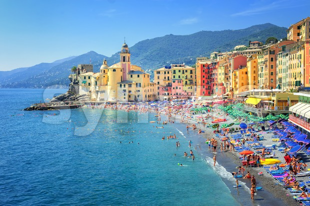 Sand beach in Camogli, historical mediterranean resort town by Genoa, Italy