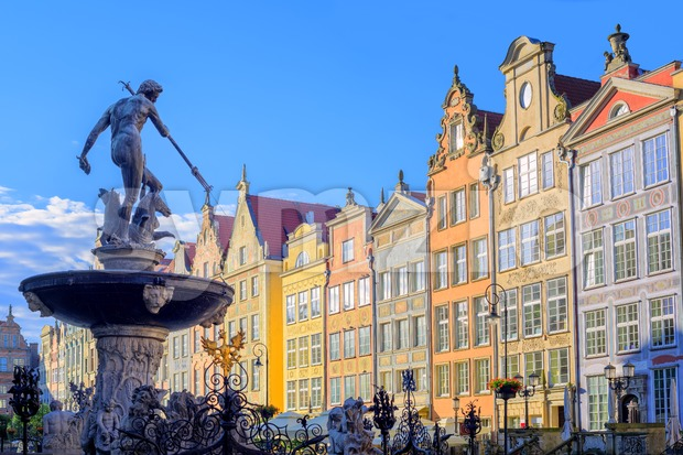 Neptune statue with colorful houses in background, Gdansk, Poland Stock Photo