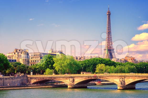 Eiffel tower rising over Seine river, Paris, France Stock Photo