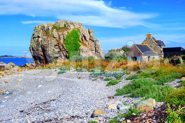 House and a rock on atlantic beach, Brittany, France Stock Photo