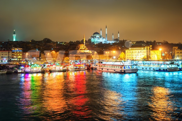 Fish boat restaurants on Golden Horn at night, Istanbul, Turkey Stock Photo