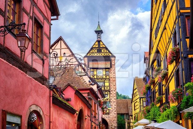 Colorful houses on a central street in Riquewihr, village on wine route in Alsace, France