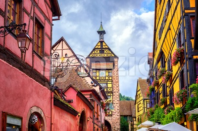 Colorful houses on a central street in Riquewihr, village on wine route in Alsace, France Stock Photo