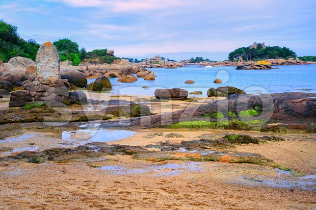 Sand beach in a lagoon by Tregastel on English Channel Pink Granite Coast, Brittany, France
