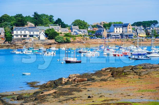 Yachts in a bay of Tregastel town on Cote de Granit Rose, Atlantic ocean, Brittany, France