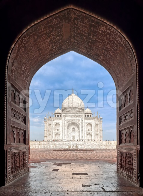 View of Taj Mahal masoleum through a gate arch, Agra, India