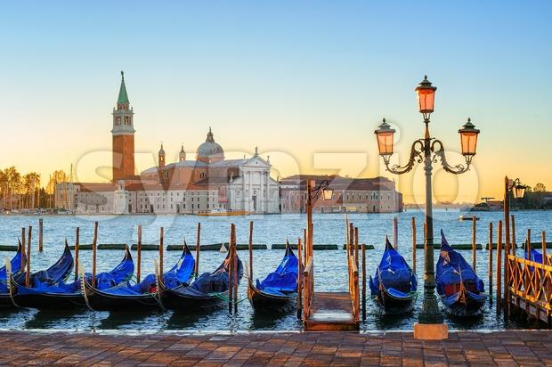 Gondolas on San Marco square with San Giorgio Maggiore island in background, Venice, Italy, on sunrise