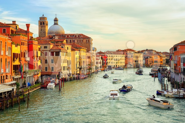 Boats crossing the Grand Canal on early morning, Venice, Italy