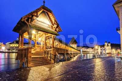 Lucerne, Switzerland, entrance to wooden Chapel Bridge at late evening Stock Photo