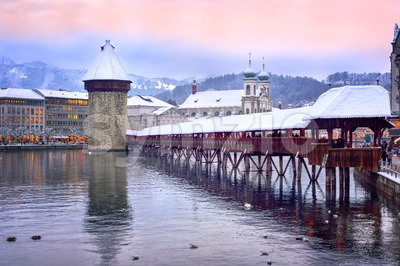 Lucerne, Switzerland, Chapel bridge, Water tower and Jesuit church on a winter evening Stock Photo