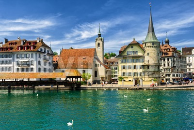 Lucerne, Switzerland, view over Reuss river to the old town, the Chapel and wooden Chapel bridge Stock Photo