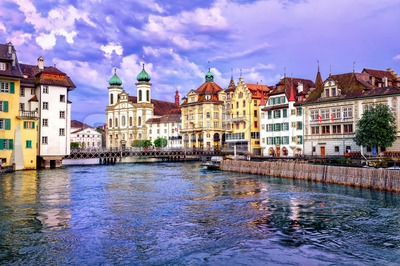 Lucerne, Switzerland, on sunset. View over Reuss river to Jesuit Church Stock Photo
