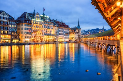 Lucerne, Switzerland, view of the old town from wooden Chapel bridge in the evening Stock Photo