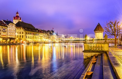 Lucerne, Switzerland. View over Reuss river to the old town and Water tower in the evening. Stock Photo