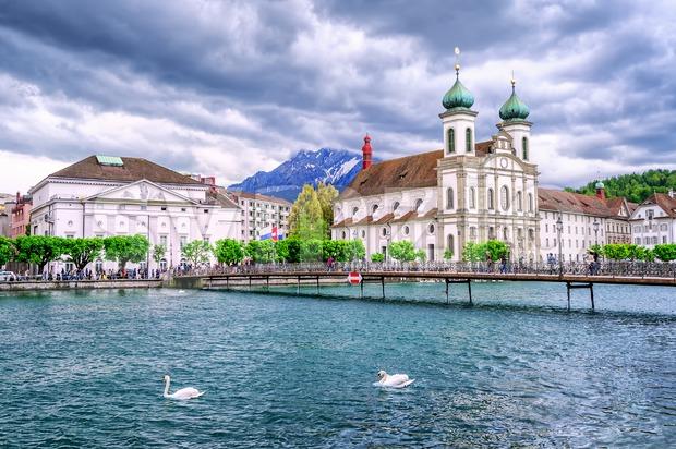 Lucerne, Switzerland, Jesuite churche, Reuss river and Mount Pilatus in background