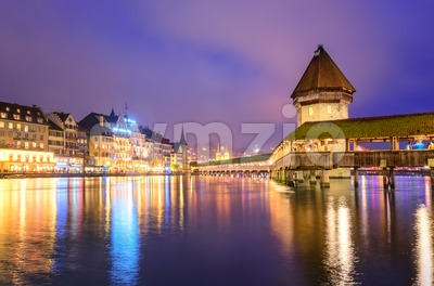 Lucerne, Switzerland, night view over the Reuss river to the wooden Chapel bridge and Water tower Stock Photo