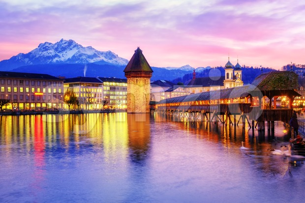 Chapel bridge, Water tower and Mount Pilatus on sunset, Lucerne, Switzerland.