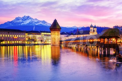 Chapel bridge, Water tower and Mount Pilatus on sunset, Lucerne, Switzerland. Stock Photo