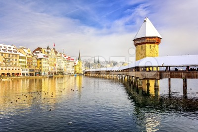 Lucerne, Switzerland, Chapel bridge and Water Tower on a snowy winter day Stock Photo