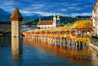Lucerne, Switzerland, Chapel Bridge, Water Tower, Jesuit Church skyline on sunrise Stock Photo