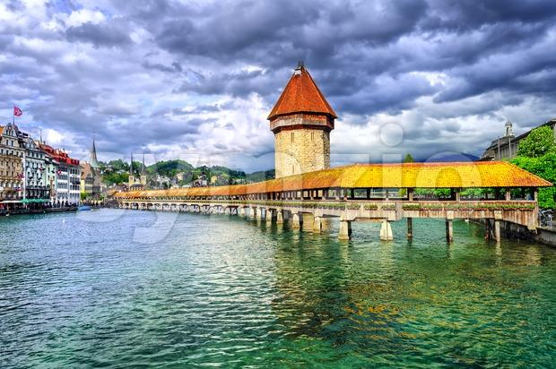 Lucerne, Switzerland, wooden Chapel bridge over Reuss river and Water tower Stock Photo