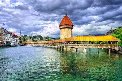 Lucerne, Switzerland, wooden Chapel bridge over Reuss river and Water tower Stock Photo