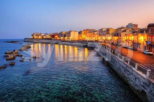 Syracuse town on sunset, Sicily, Italy Stock Photo