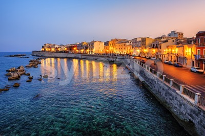 Syracuse town on sunset, Sicily, Italy Stock Photo