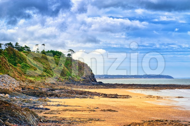 Desolated atlantic beach in Normandy by Granville, France
