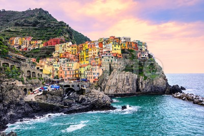 Colorful houses on a rock in Manarola, Cinque Terre, Italy Stock Photo