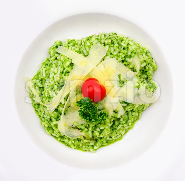 Risotto al Pesto with parmesan cheese Stock Photo
