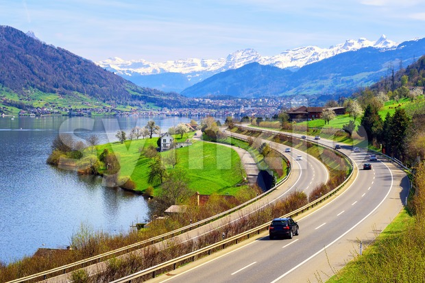 View of a highway between Lake Zug and Alps mountain range in central Switzerland