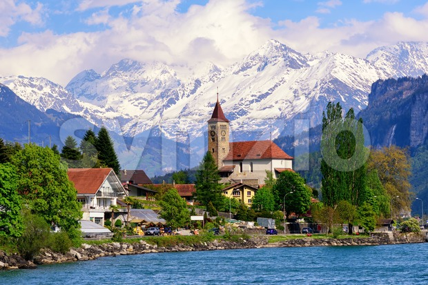 Brienz town near Interlaken and snow covered Alps mountains, Switzerland Stock Photo